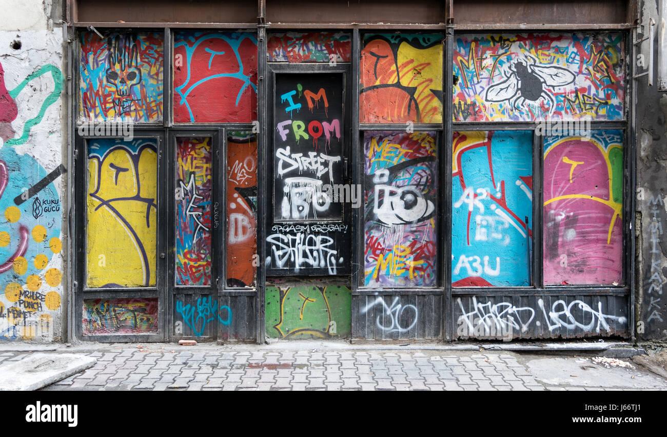 Grunge wooden door with random paints, Istanbul, Turkey - Stock Image