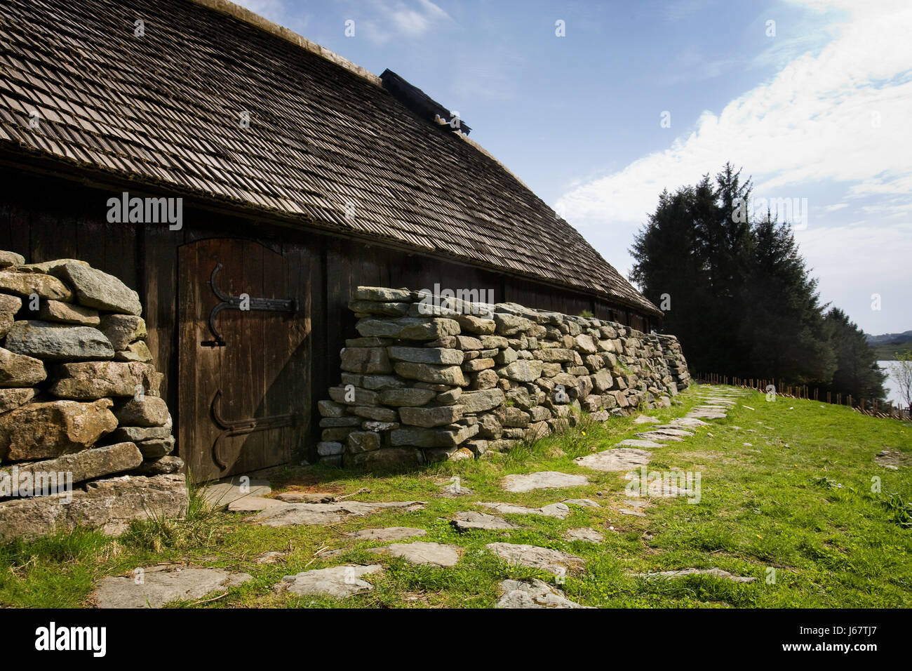 House building stone wood rock wall norway farm style of for Stone house construction