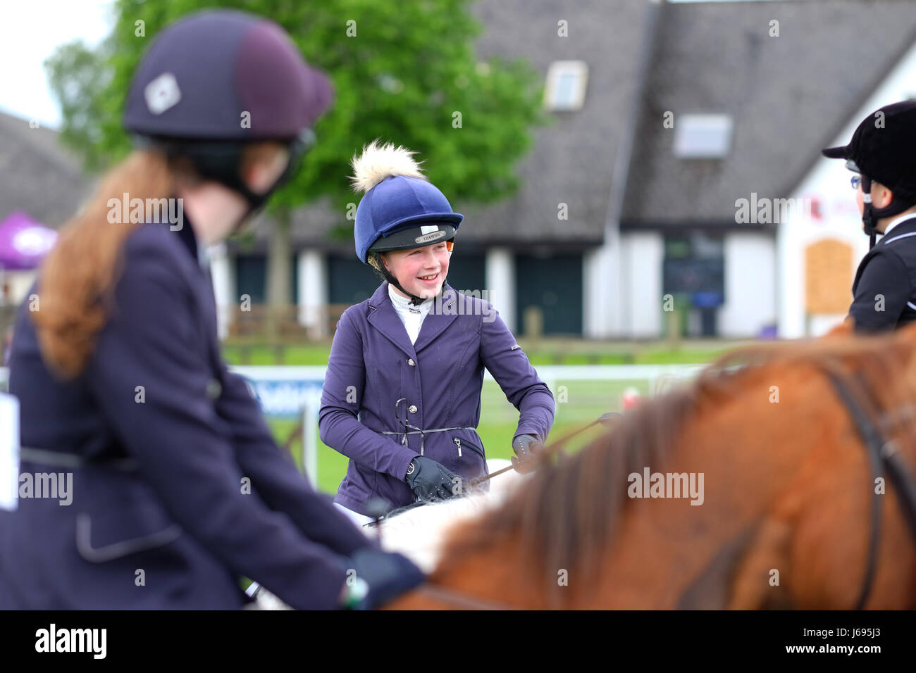 Royal Welsh Spring Festival, Builth Wells, Powys, Wales - May 2017 - Competitors in the junior show jumping event - Stock Image