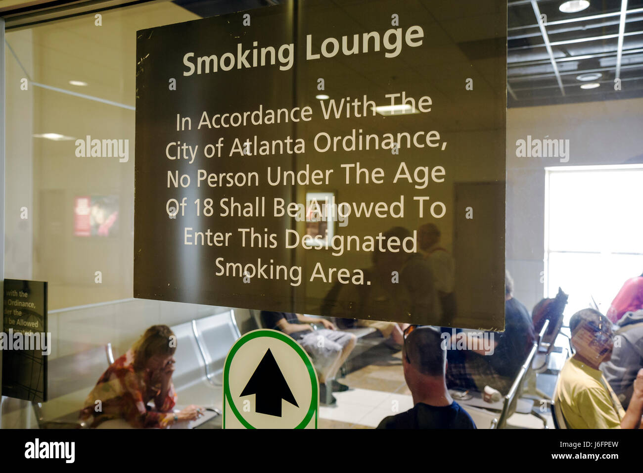 Atlanta Georgia Hartsfield-Jackson Atlanta International Airport smoking lounge vice addiction restriction warning - Stock Image