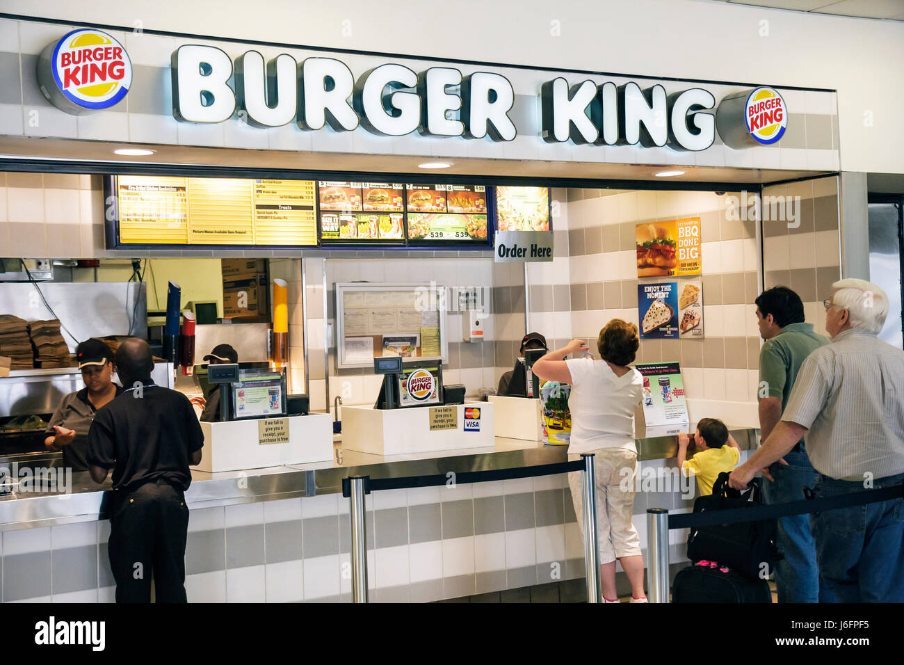 Atlanta Georgia Hartsfield-Jackson Atlanta International Airport Burger King fast food concession cashier customer - Stock Image