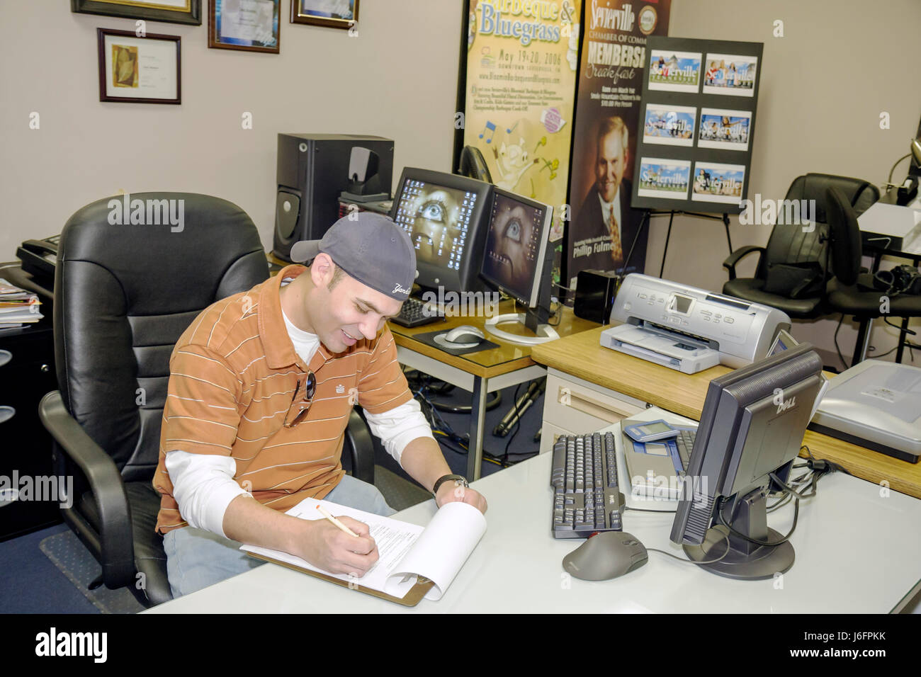 Tennessee Sevierville Chamber of Commerce Technical Operations IT man write office desktop computer screen work - Stock Image