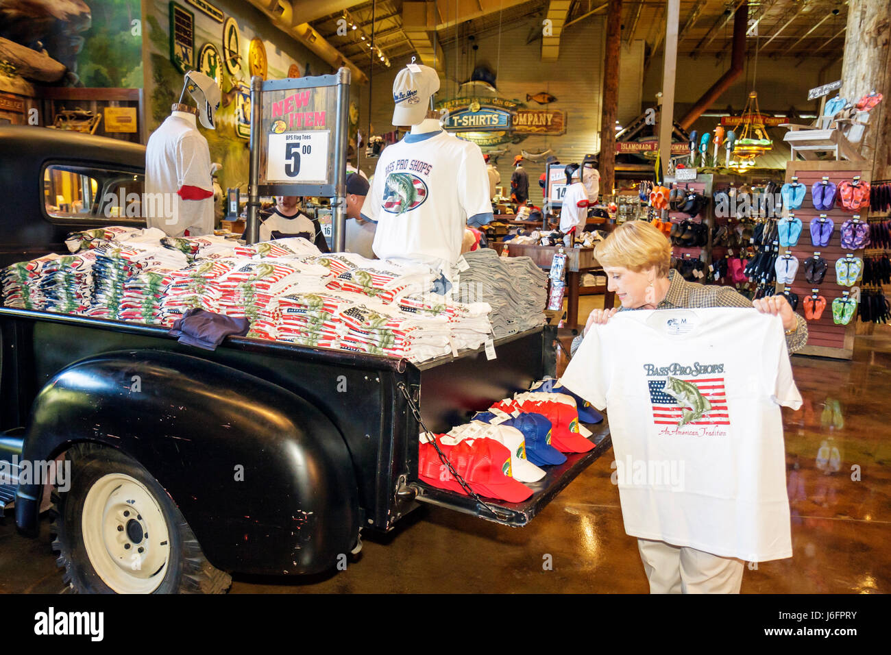 Tennessee Sevierville Kodak Bass Pro Shops woman senior display merchandise sporting goods outdoor recreation company - Stock Image