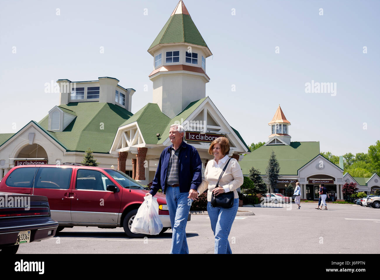 Tennessee Sevierville Tanger Outlets at Five Oaks shopping woman man couple hold hands shopping outdoor mall retail - Stock Image