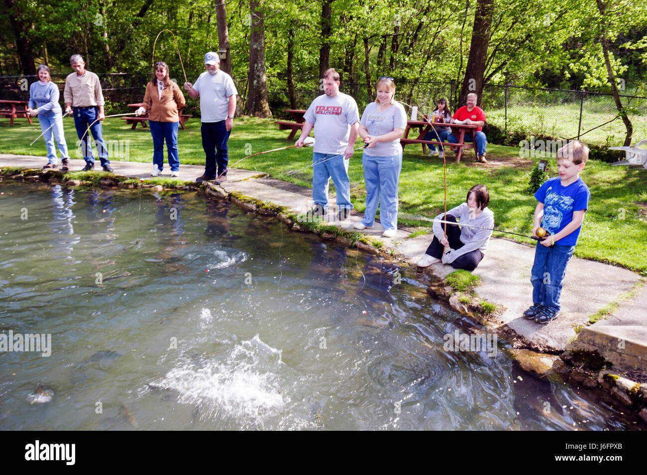 Taking kids fishing stock photos taking kids fishing for Trout farm fishing