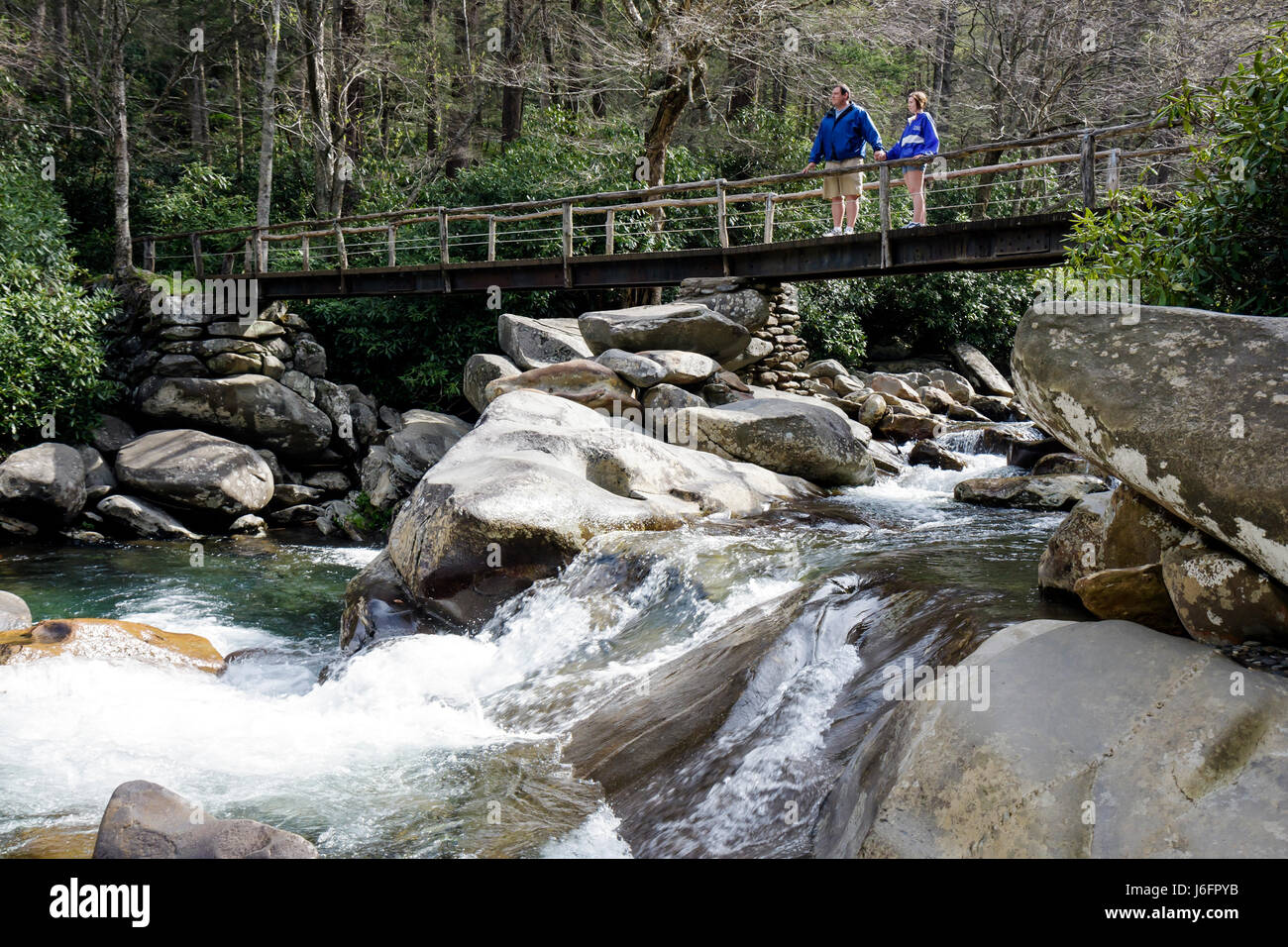 Tennessee Great Smoky Mountains National Park Little Pigeon River man woman couple rock waterfall bridge scenery - Stock Image