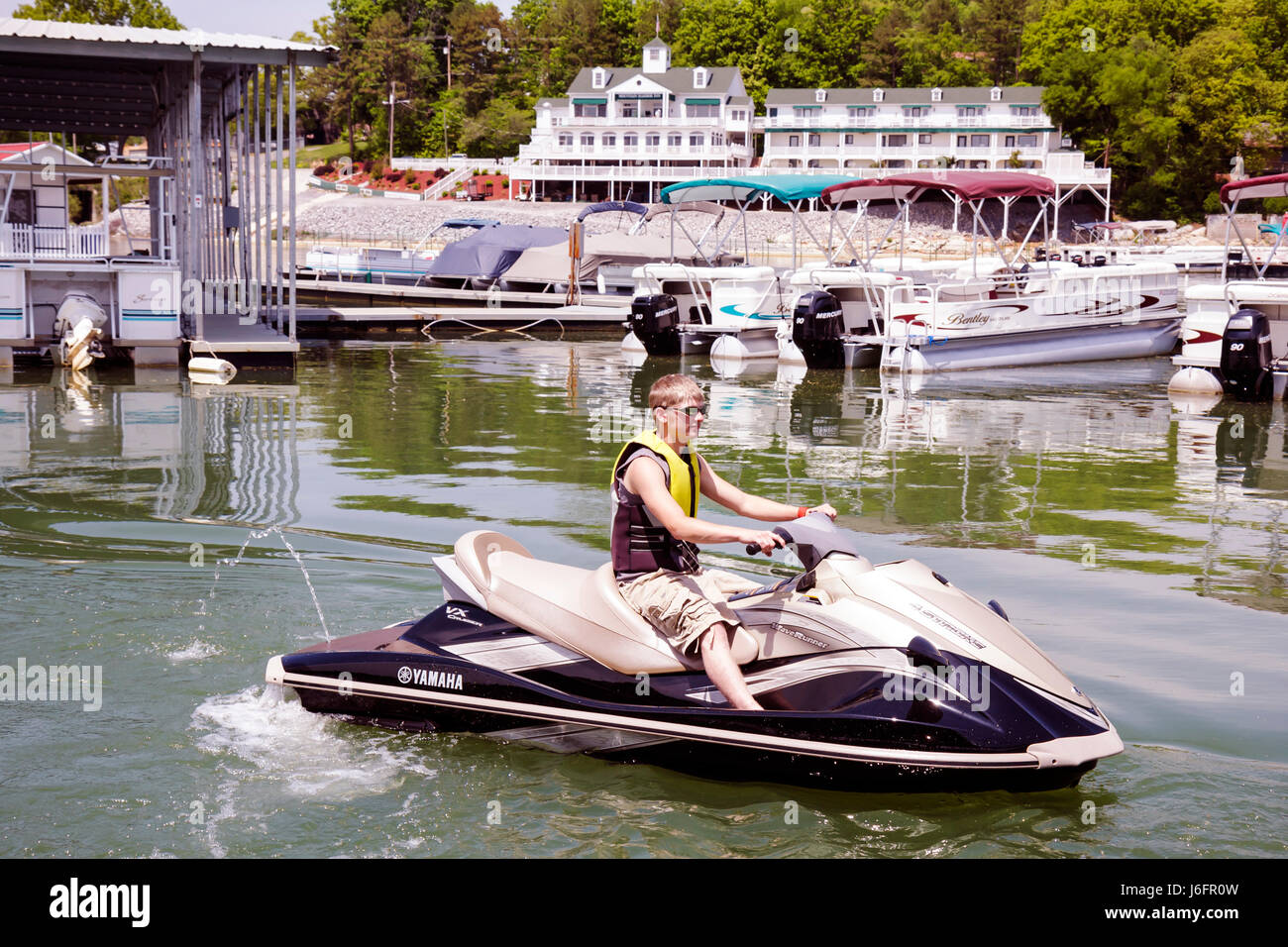 Tennessee Sevierville Douglas Lake jet ski wave runner Lighthouse Marina teen boy water sport - Stock Image