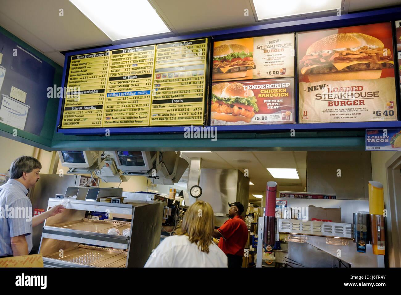 Wisconsin Kenosha Burger King fast food hamburger restaurant chain franchise menu choice Black man men woman counter - Stock Image