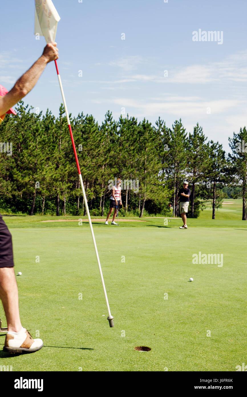 Wisconsin Kenosha Kansasville Brighton Dale Links golf course county park system man men woman play putting green - Stock Image