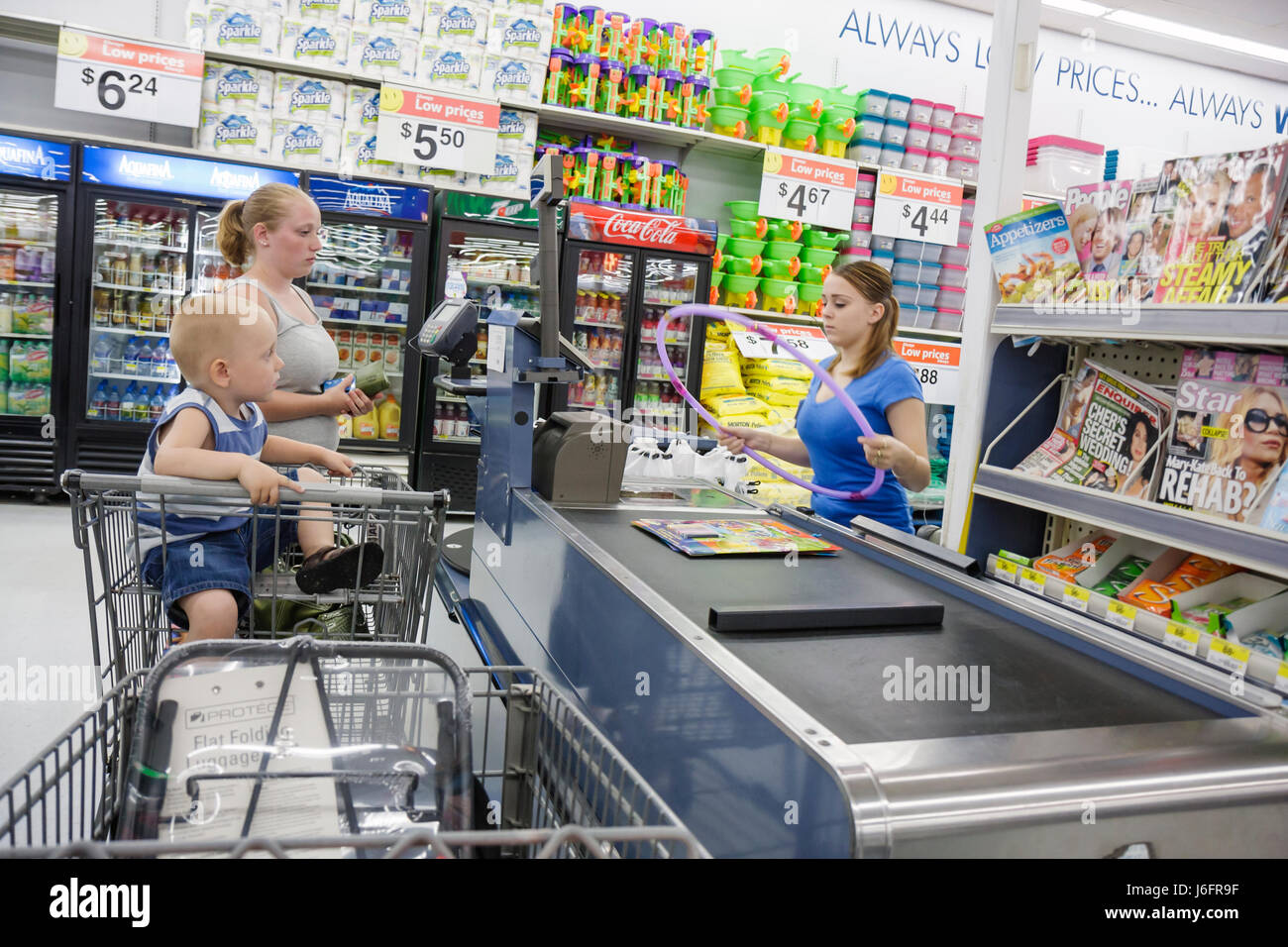 Wisconsin Kenosha Walmart Wal-Mart discount superstore retailer woman boy toddler girl cashier teen job shopping - Stock Image
