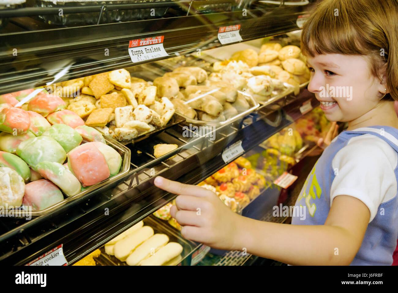 Wisconsin Kenosha Tenuta's Delicatessen Liquors and Wines girl tray food bakery dessert Italian market pastry - Stock Image