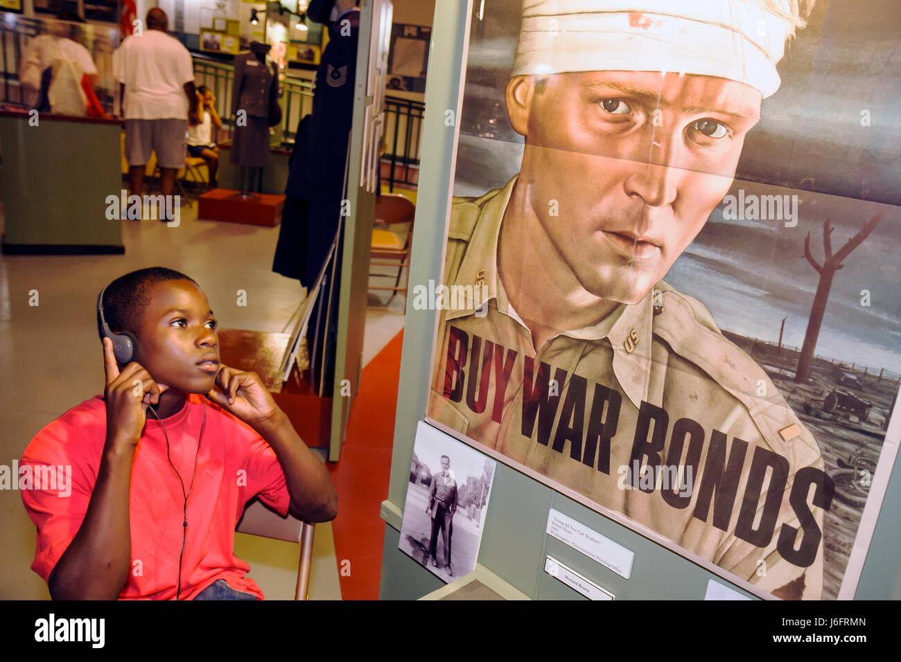 Wisconsin Kenosha Simmons Island Kenosha History Center Black boy WWII World War Two war bonds poster education - Stock Image