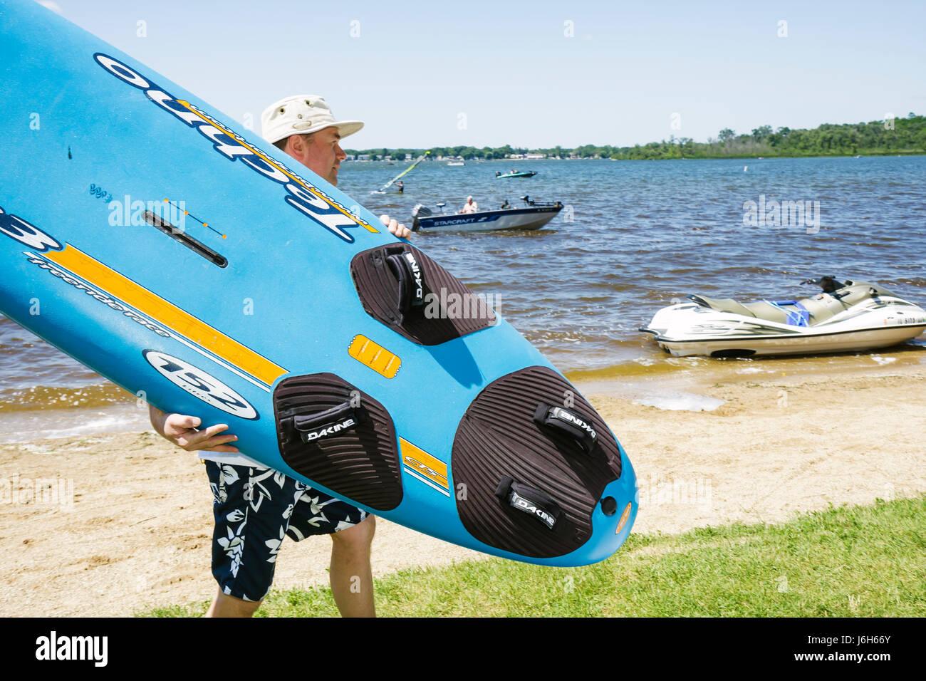 Wisconsin Kenosha Silver Lake Silver Lake Park water ski man windsurf board - Stock Image