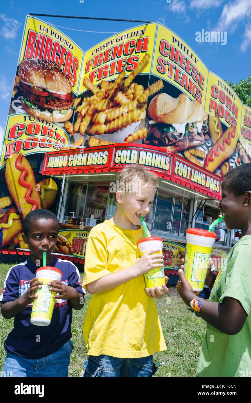 Wisconsin Kenosha Kenosha County Fairgrounds The Ultimate Kid Fest family event Black boy lemonade drinks straws - Stock Image