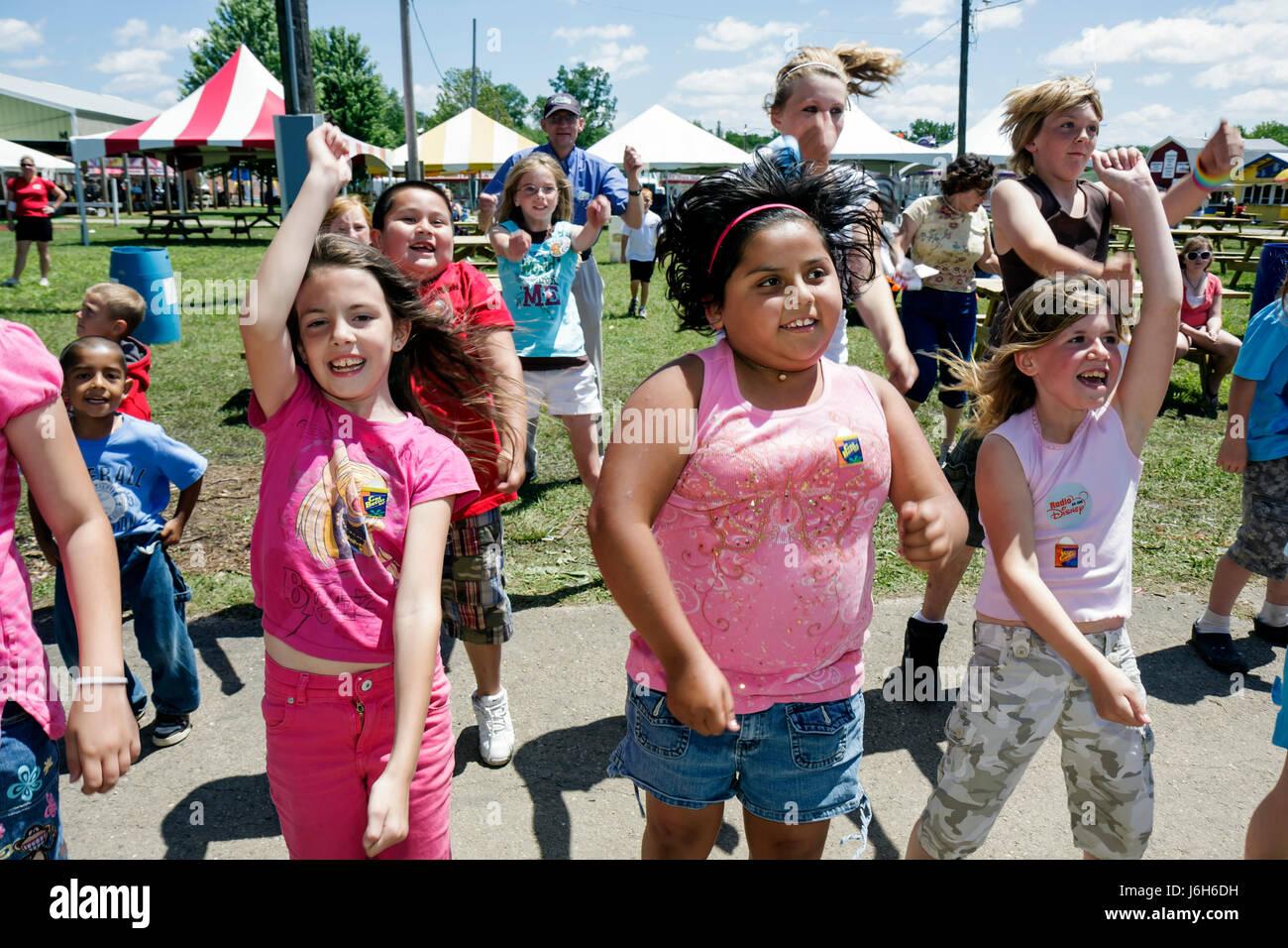 Wisconsin Kenosha Kenosha County Fairgrounds The Ultimate Kid Fest family event Hispanic girl boy childhood fun - Stock Image