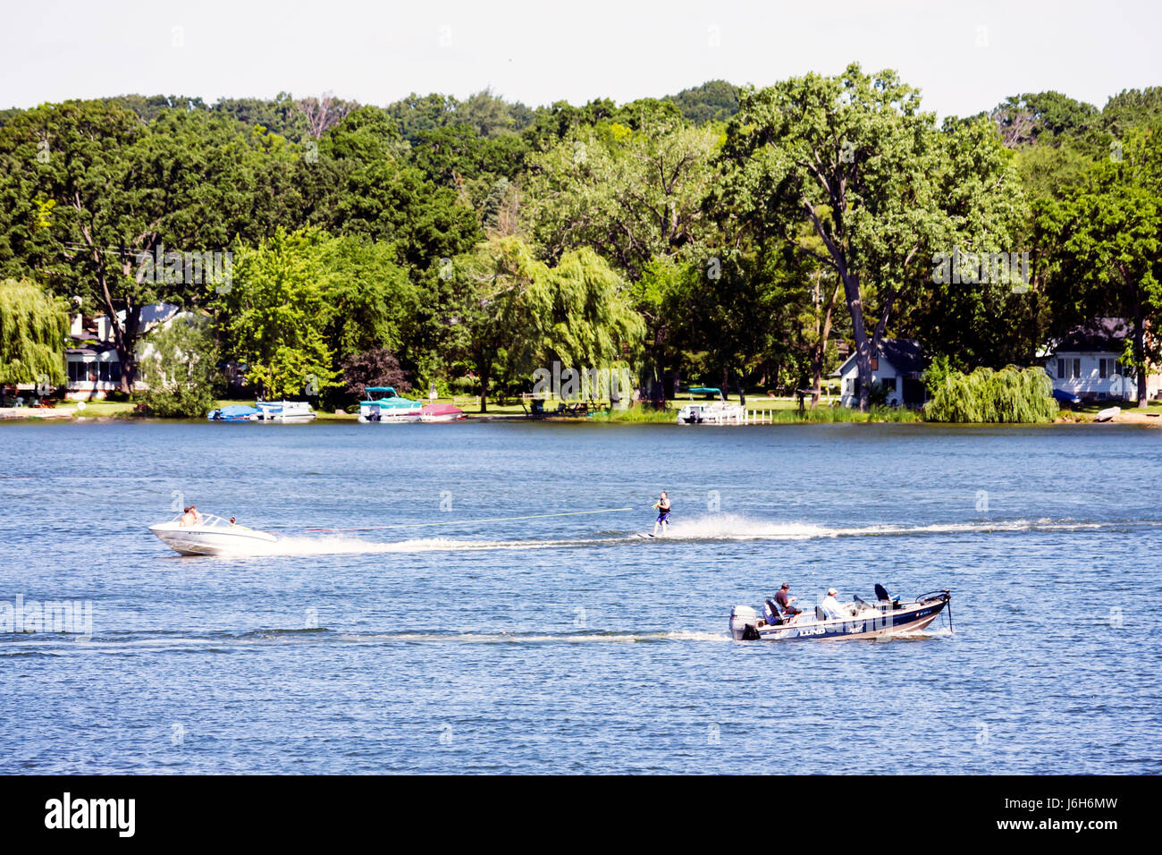 Wisconsin Kenosha Paddock Lake Old Settlers Park motor boat water skiing skier sport recreation speed fun fish - Stock Image