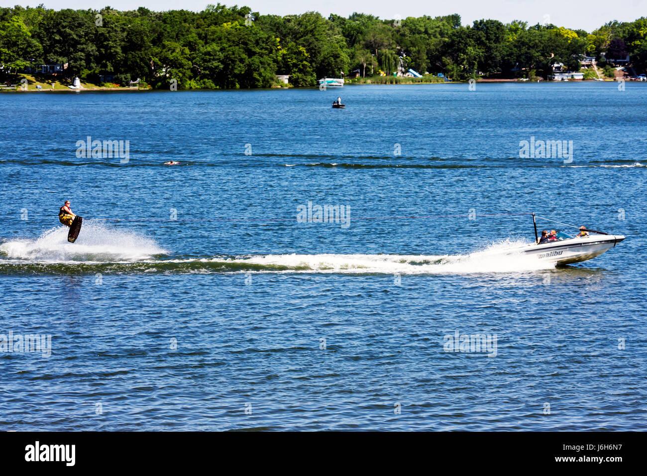 Wisconsin Kenosha Paddock Lake Old Settlers Park motor boat water skiing skier sport recreation speed fun lake - Stock Image