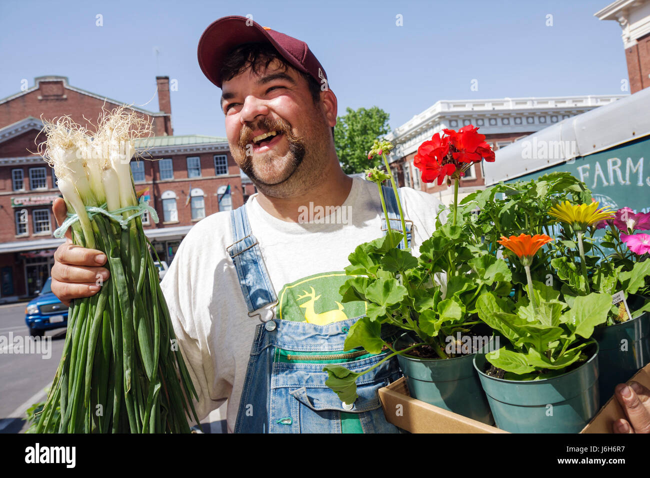 Virginia Roanoke Market Square Farmers' Market man local produce vegetables flowers plants overalls country - Stock Image