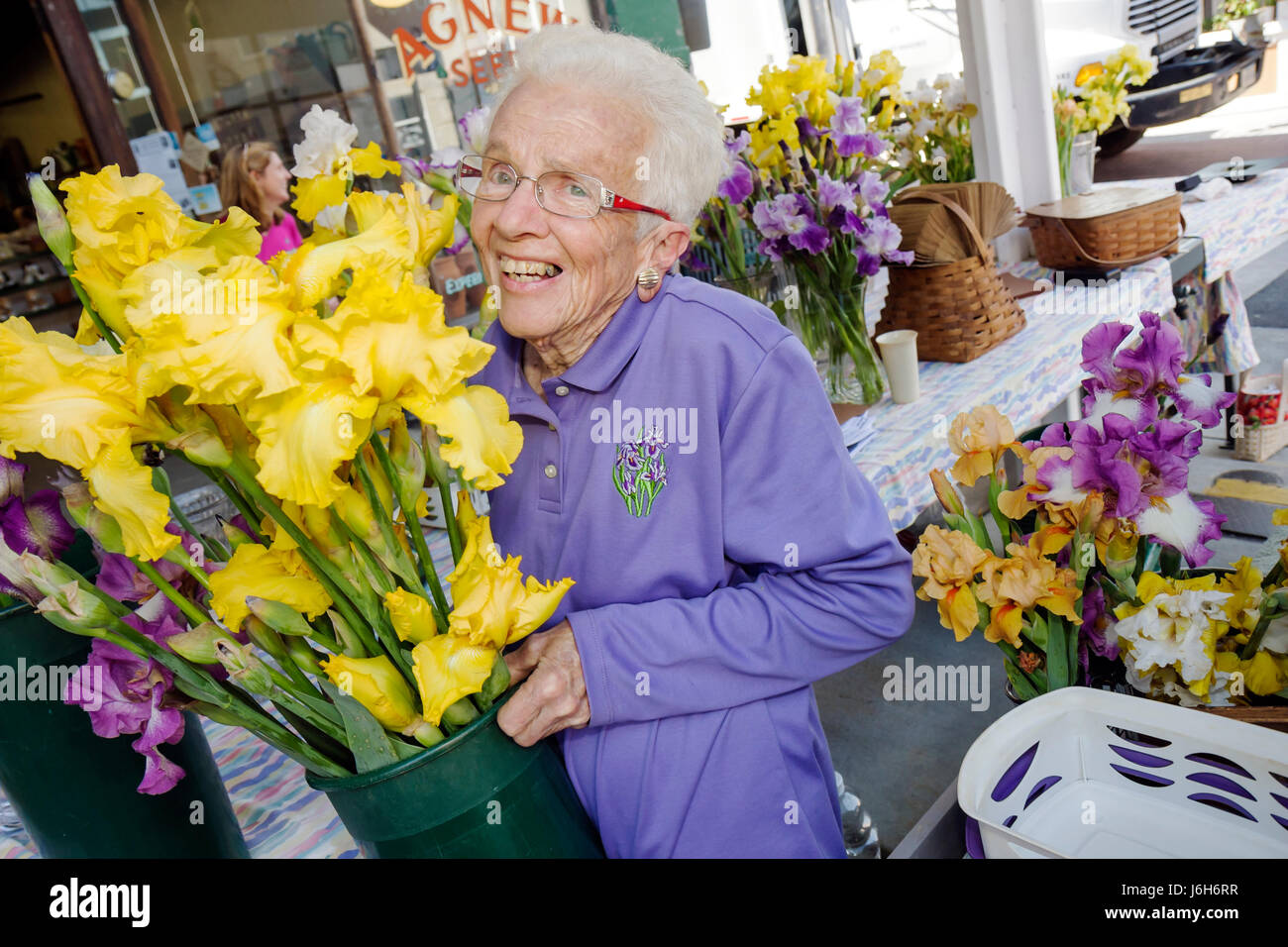 Virginia Roanoke Market Square Farmers' Market woman senior active working smiling flower shop florist vases - Stock Image