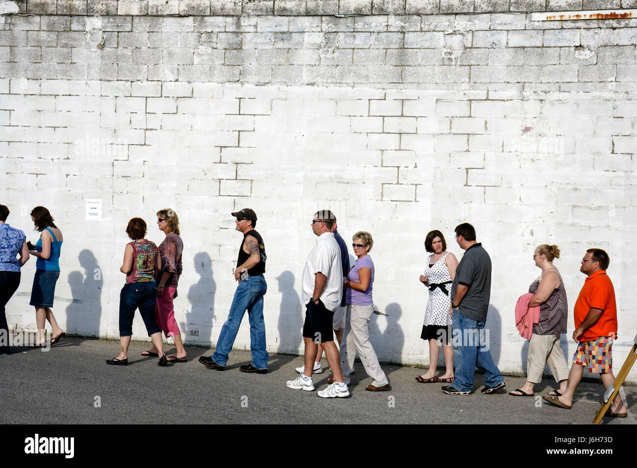 Virginia Roanoke Railside Stage First Fridays downtown street festival man men woman women wait in line queue attend - Stock Image