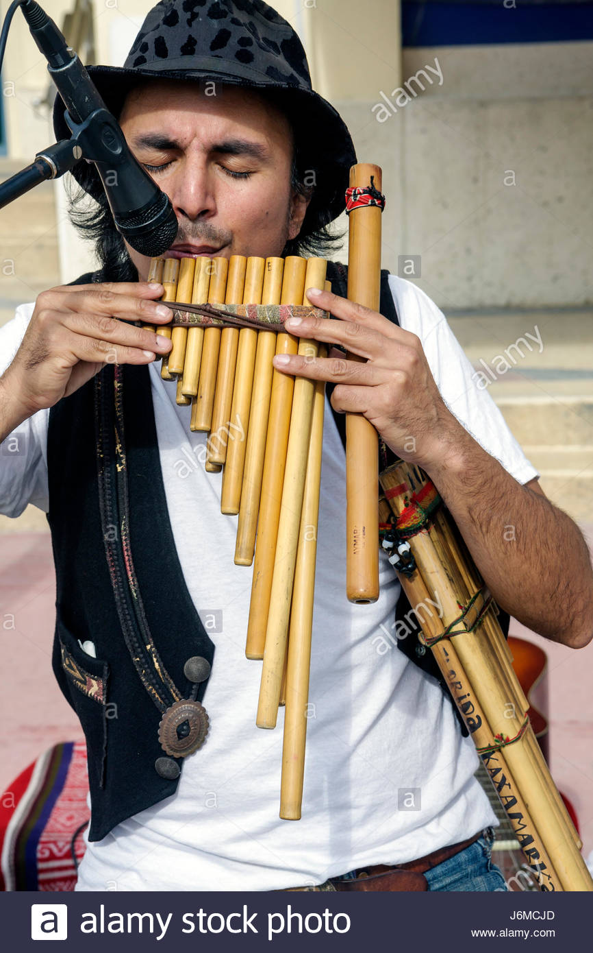 Miami Beach Florida 22nd Street Collins Park Sunday Market Hispanic man plays Peruvian flute microphone - Stock Image