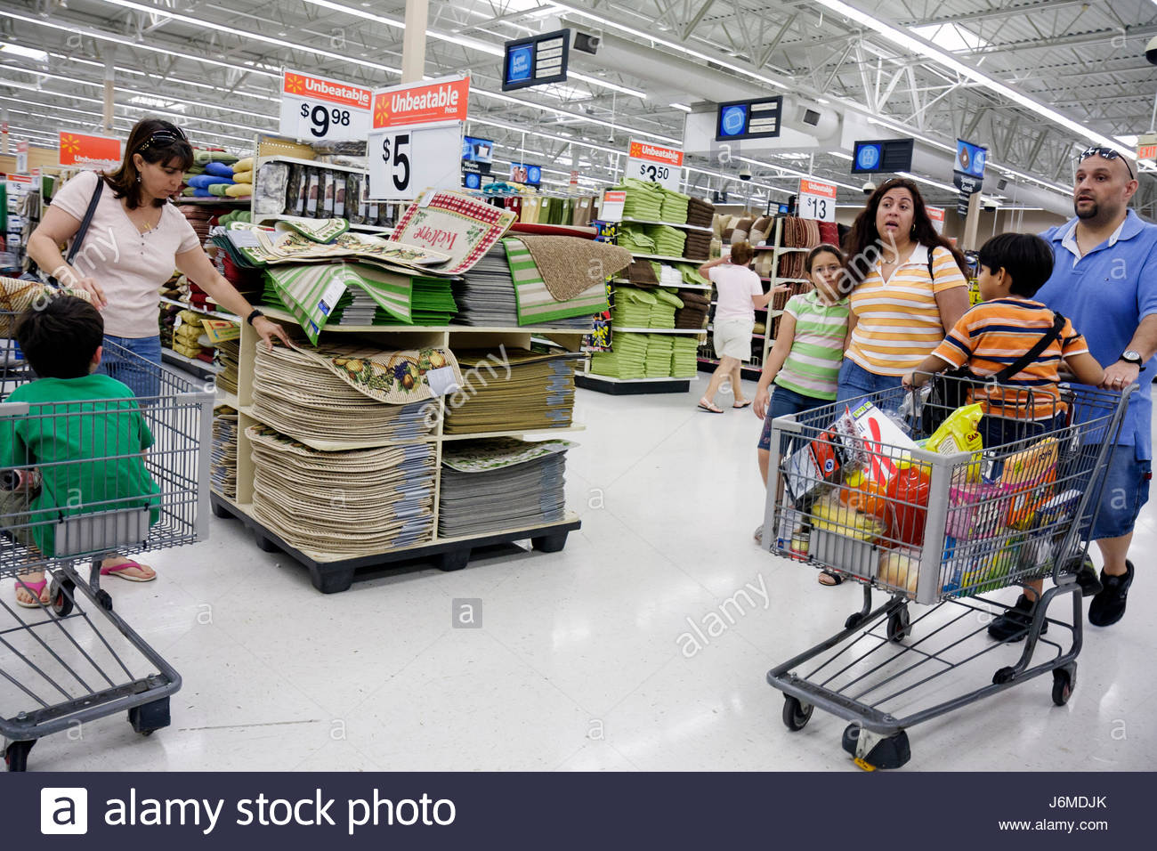 Miami Hialeah Florida Wal-Mart Walmart shopping for sale retail display Hispanic family mother father children boy - Stock Image