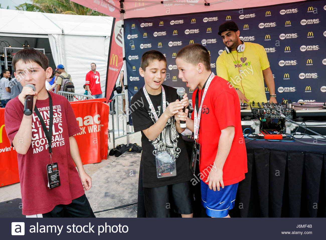 Miami Beach Florida Super Bowl XLIV Week NFL football product promotion dj deejay boy microphone rapping - Stock Image