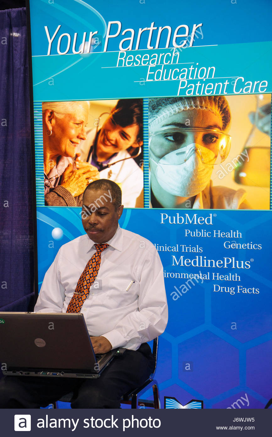Miami Beach Miami Florida Beach Convention Center centre Health and Fitness Expo exhibitors Black man laptop computer - Stock Image
