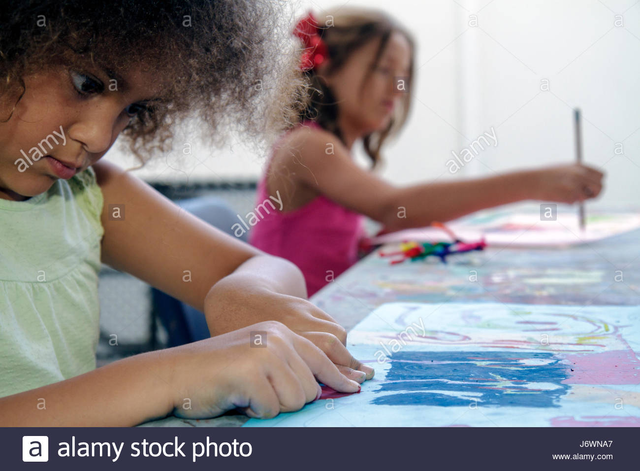 Miami Beach Florida ArtCenter South Florida Art Camp class Black girl chalk drawing - Stock Image