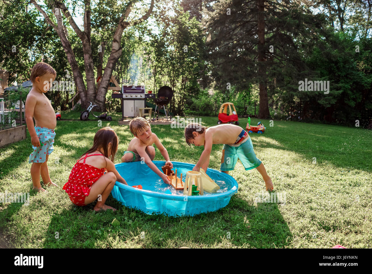 Paddling pool garden girl stock photos paddling pool for Best children s paddling pool