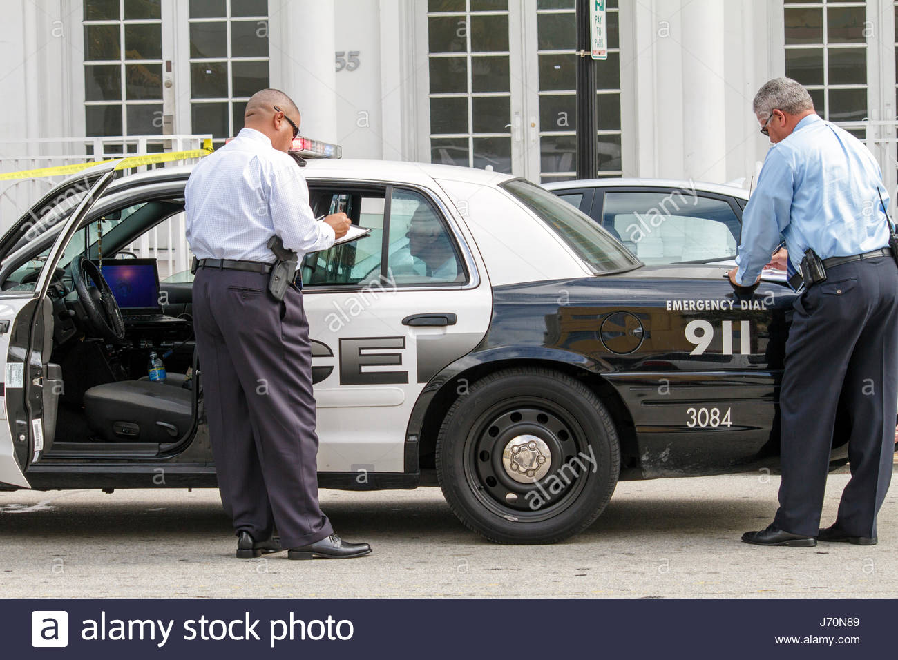 Miami Beach Florida Ocean Drive shooting crime scene murder police policeman detectives vehicle car - Stock Image