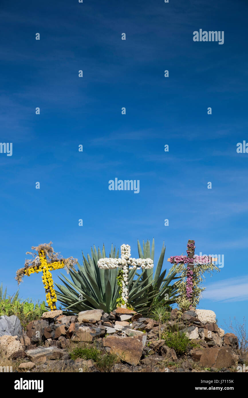 three-flower-decorated-crosses-at-the-to