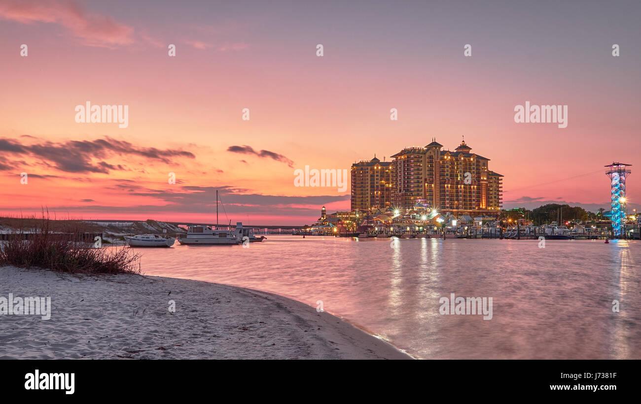 Emerald Grande Hotel at Harbor Walk in Destin, Florida at sunset. - Stock Image