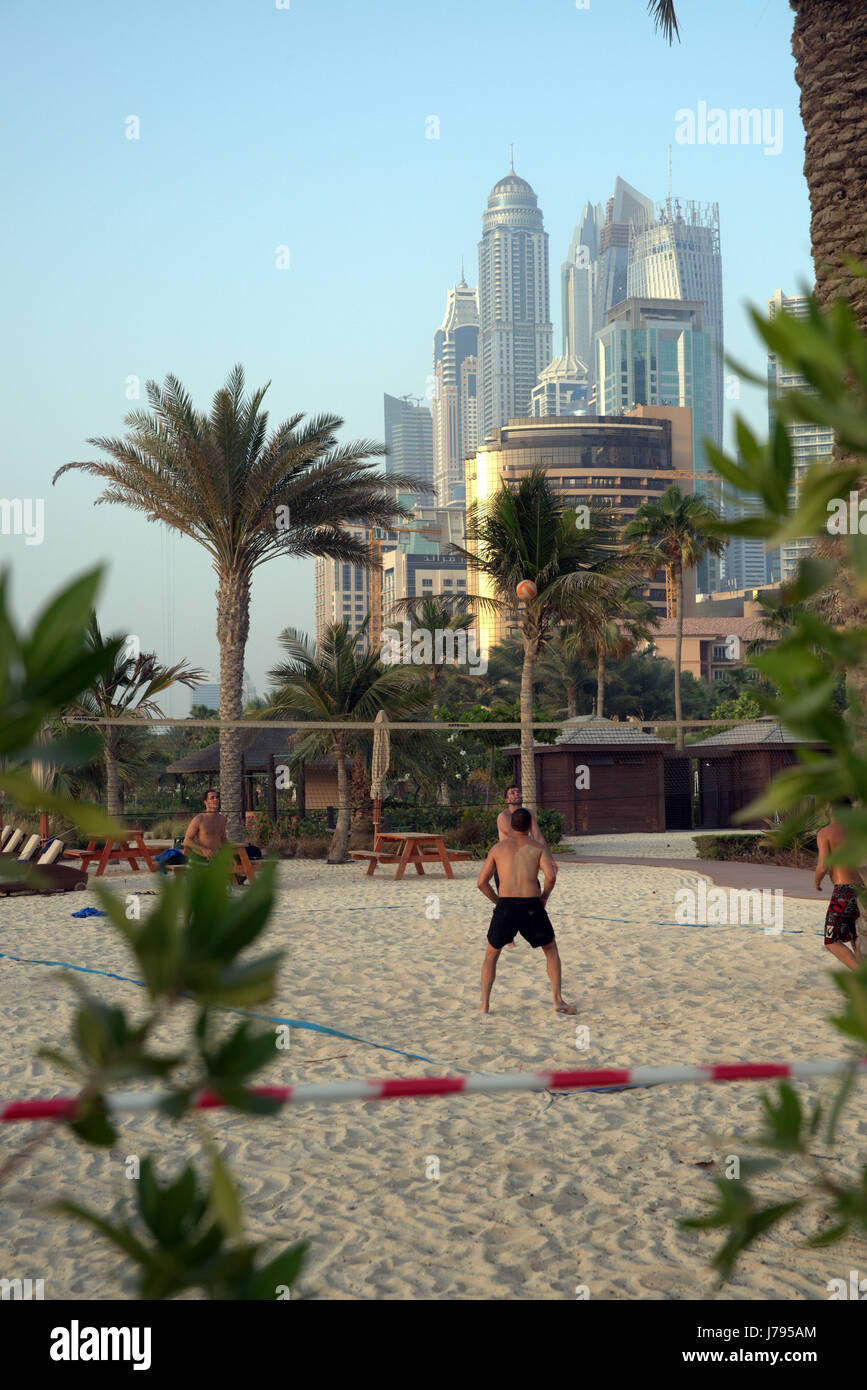 Dubai UAE Jumeira Beach Park Volley Ball On Beach with business district in the background Stock Photo