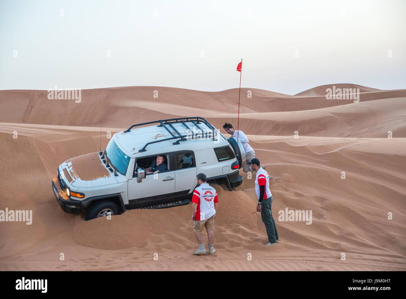 car-stuck-on-sand-whilst-off-roading-in-dubai-united-arab-emirates-J9M0H7.jpg