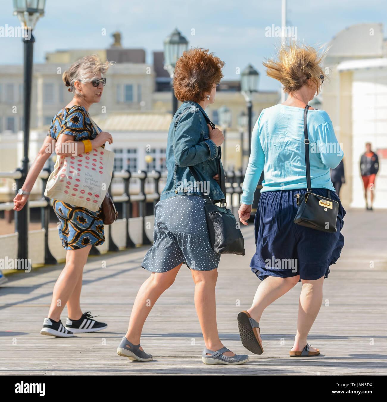 windy-day-women-walking-on-a-seaside-pie