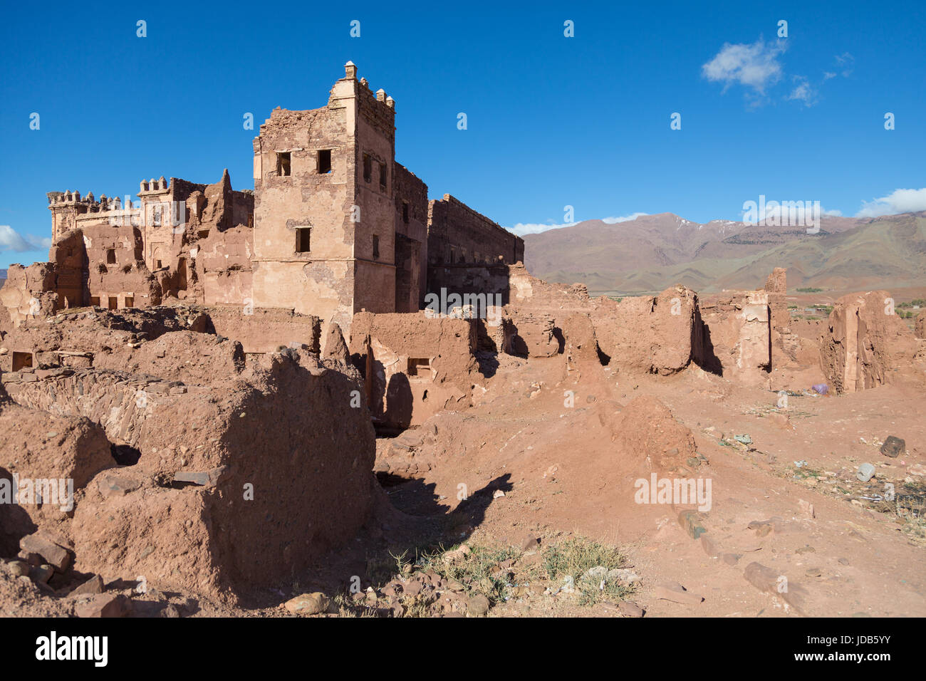 The walls of an abandoned fort in Telouet slowly crumble and decay back into the surrounding desert Stock Photo