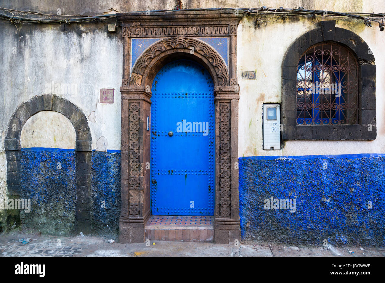 Windows and doorways of different shapes and colours on every house in the old town of Essaouira, Morocco Stock Photo