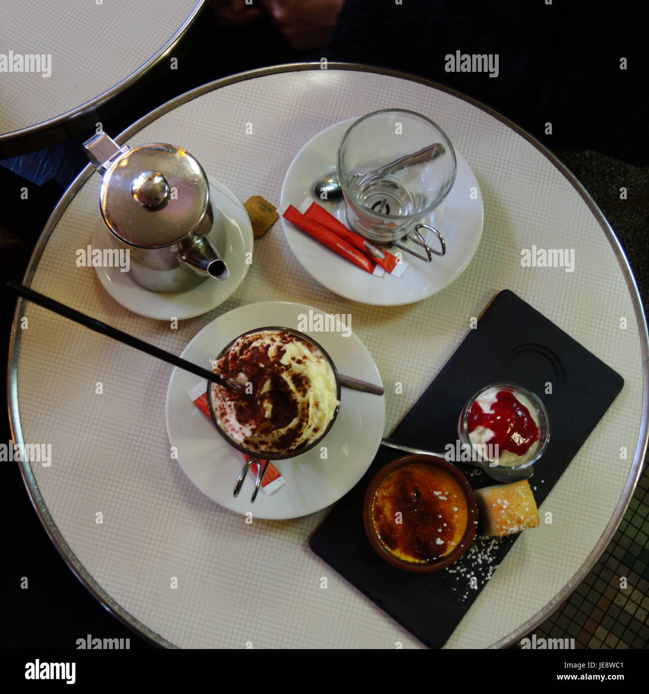 PARIS FRANCE - HOT CHOCOLATE AND TEA WITH PASTRIES AT THE CAFE - PARIS CAFE © Frédéric BEAUMONT Stock Photo
