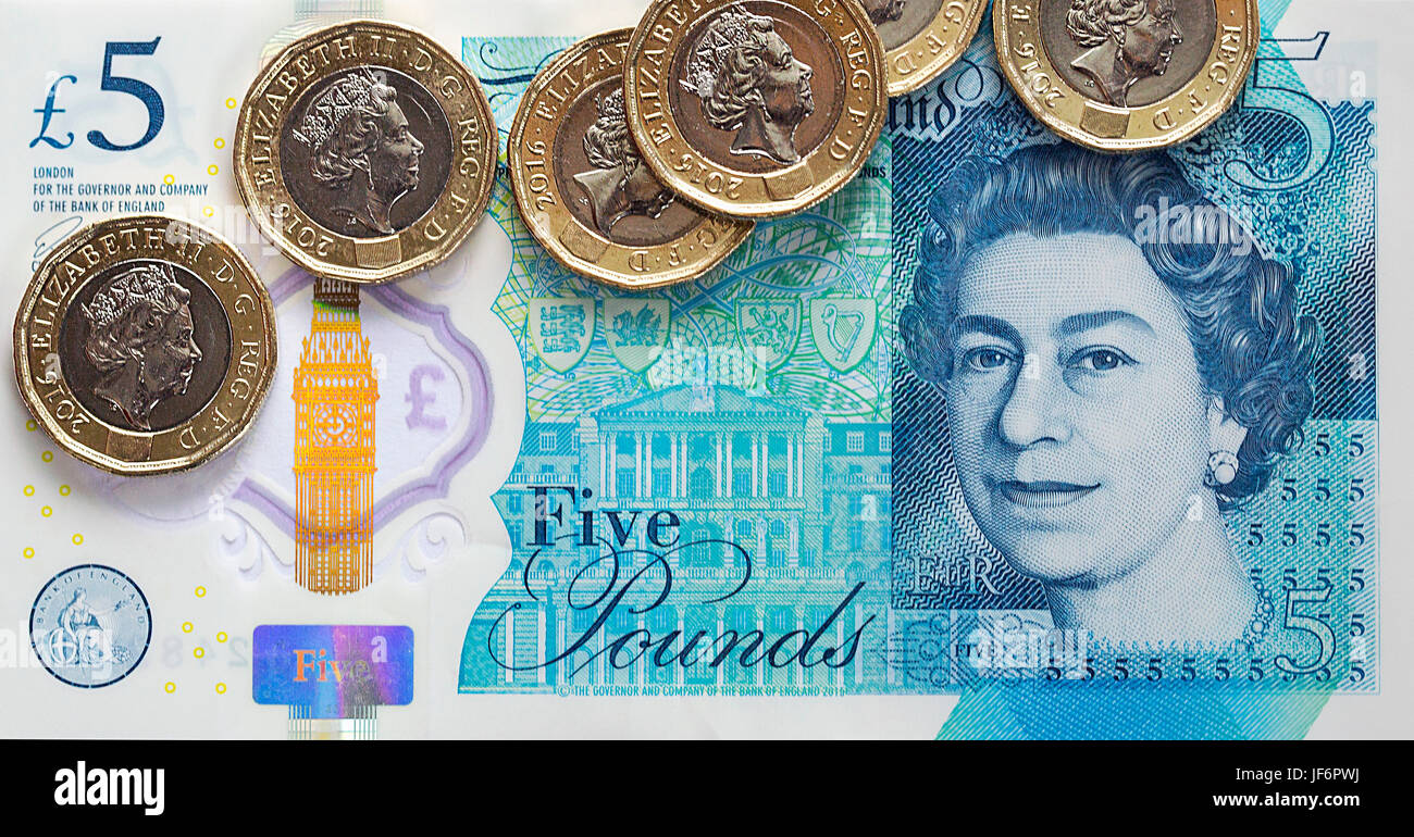 British Currency - Five Pound Note with the New 2017 Pound Coin Stock Photo