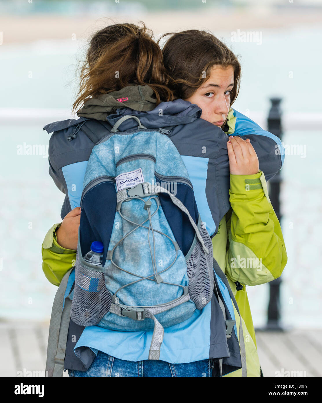 girls-hugging-young-girls-having-a-hug-to-give-comfort-as-one-of-them-JF80FY.jpg