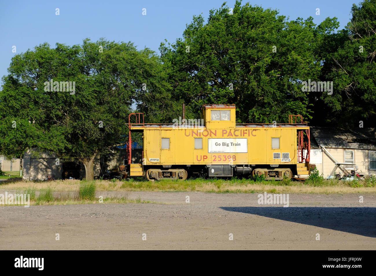 A Union Pacific Caboose Sits On An Abandoned Railroad