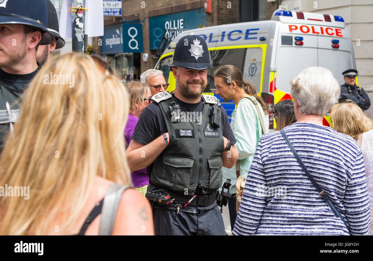 police-officer-smiling-with-hands-in-pockets-in-the-south-of-the-uk-JG0Y2H.jpg