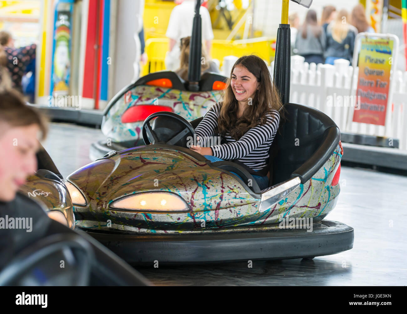 bumper-cars-young-girl-having-fun-at-the-fair-riding-on-the-dodgems-JGE3KN.jpg