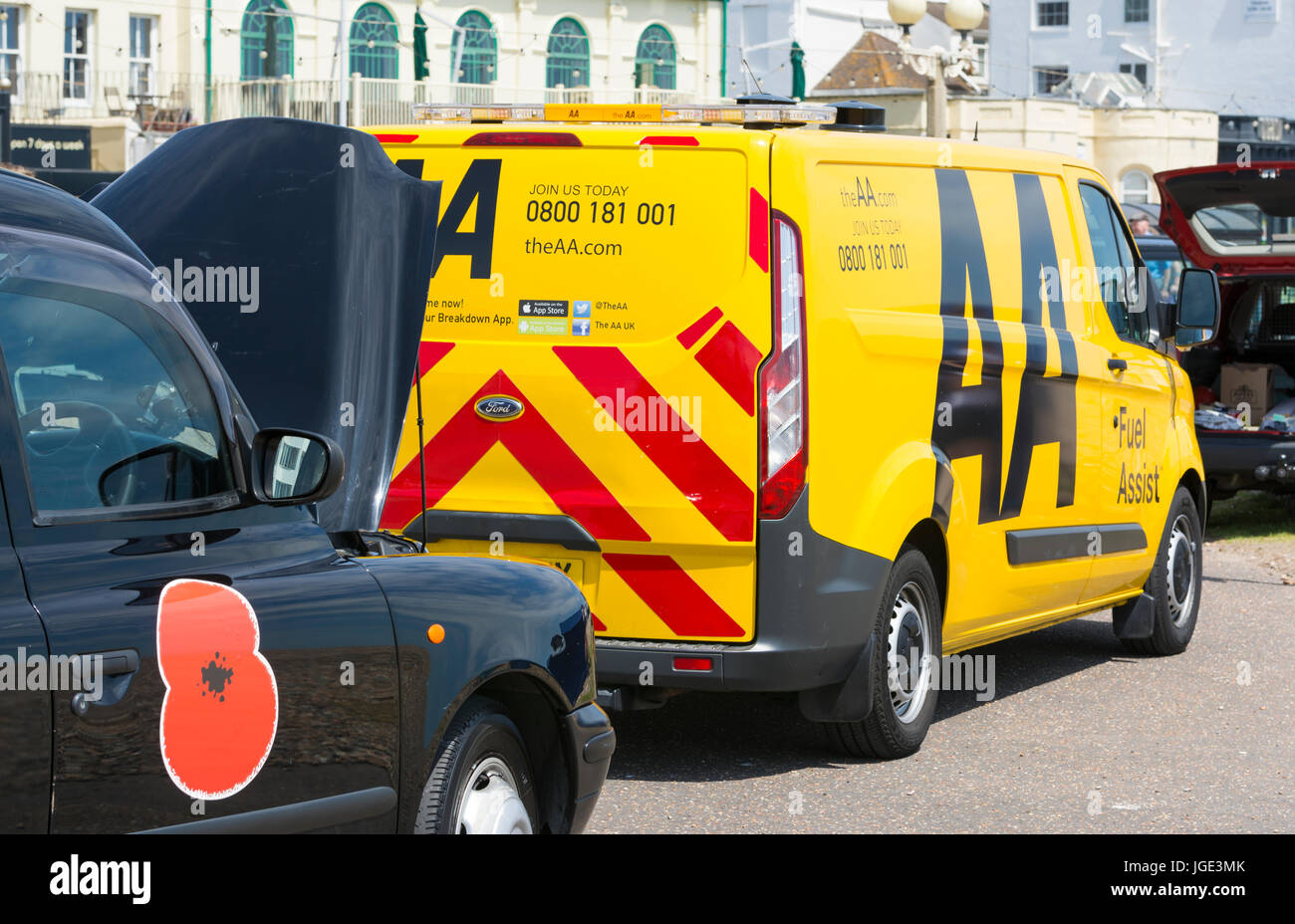 Broken down London Black cab with bonnet up and an AA van on scene. Stock Photo
