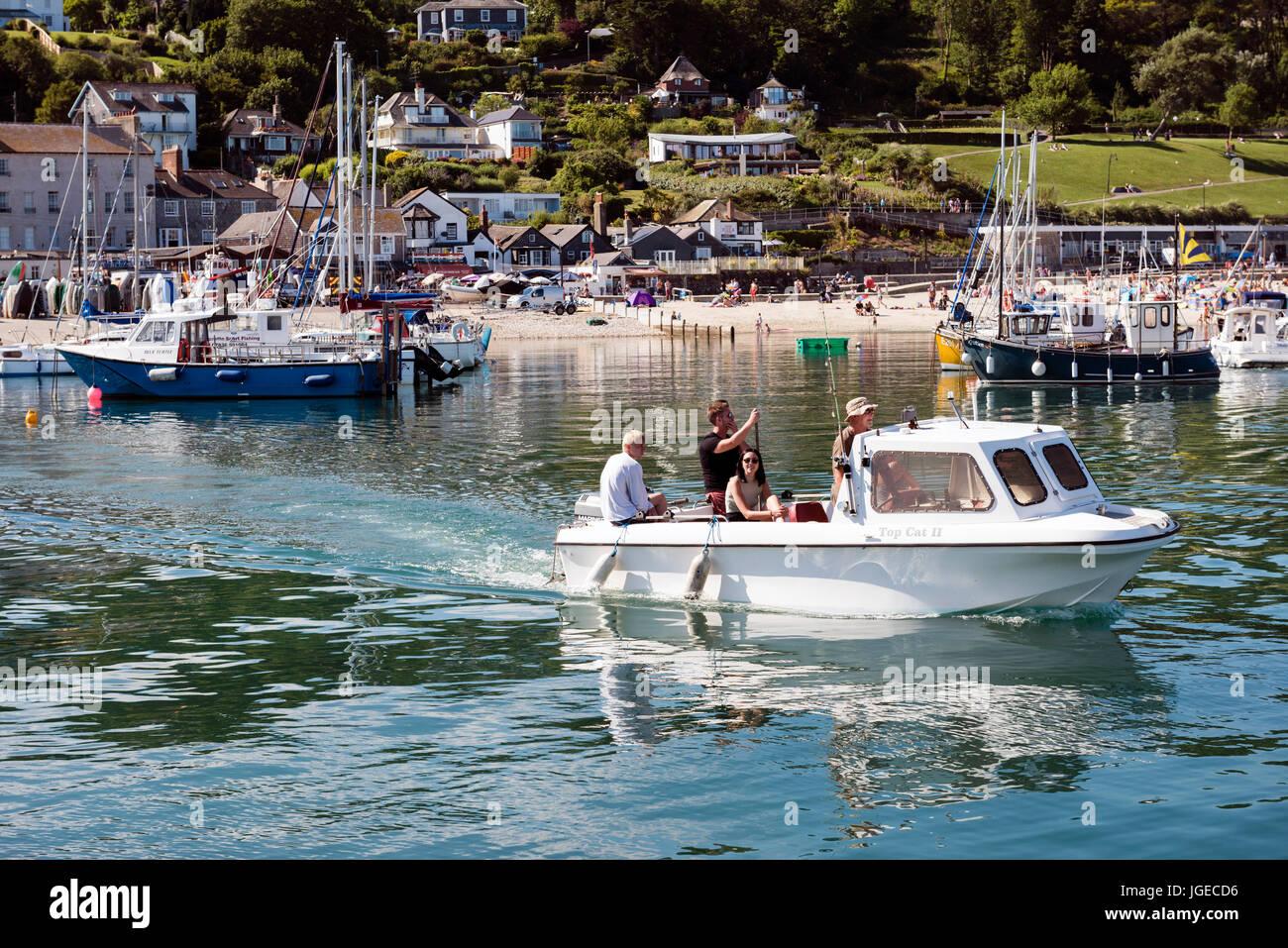 people-on-a-boat-at-the-harbour-lyme-regis-dorset-uk-JGECD6.jpg