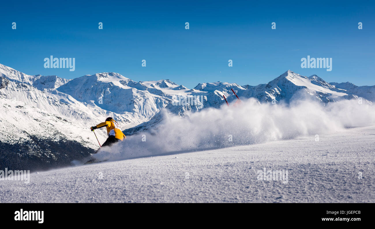 skier-in-italian-alps-on-fresh-powder-bormio-lombardy-italy-JGEPCB.jpg