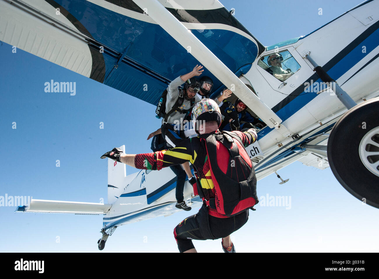 Skydivers Skydivers exiting a Pilatus Porter for a fun jump Stock Photo
