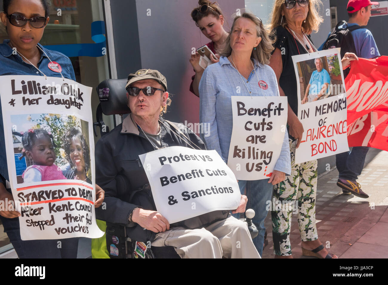 London, UK. 18th July 2017. People hold posters including two of people who died as a result of benefit cuts at Stock Photo