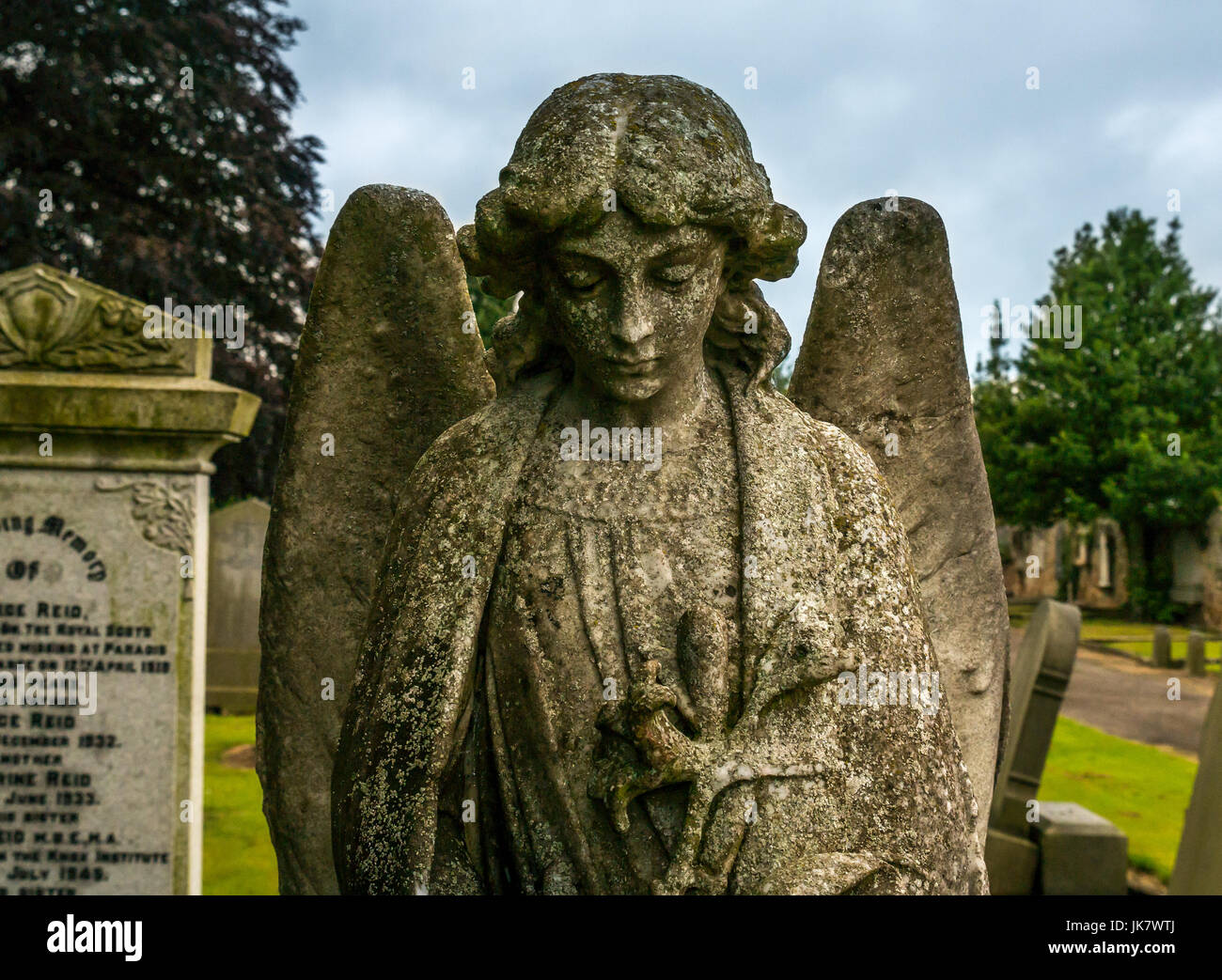 close-up-of-gravestone-stone-angel-with-